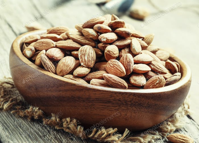 Raw almonds in bowls