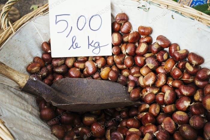 A basket of roasted sweet edible chestnuts.