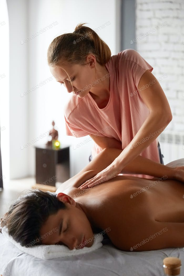 Handsome young man getting massage