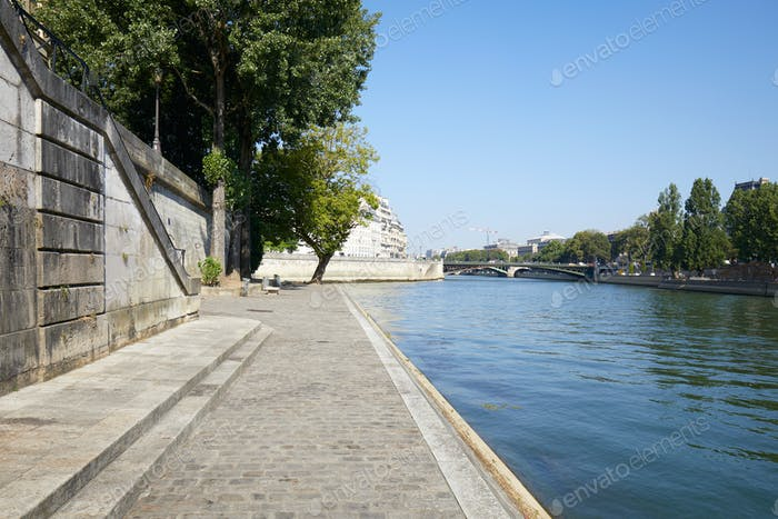 Paris, Seine river and empty docks, clear blue sky in France