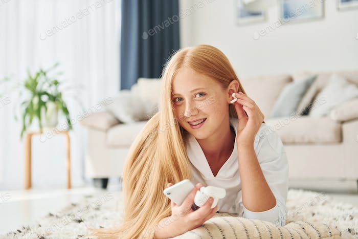 Pretty young woman is at home at daytime