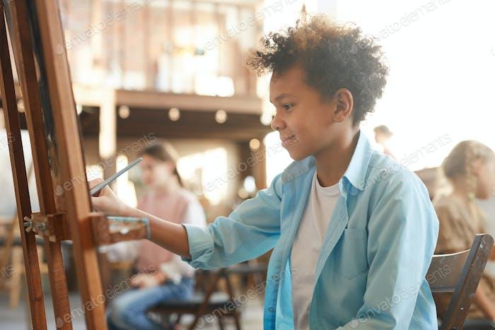 Boy at art lesson