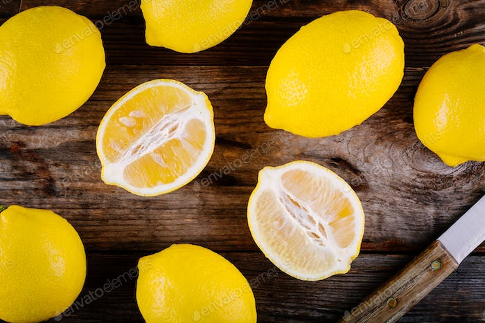 fresh organic lemons  on a wooden background. Top view