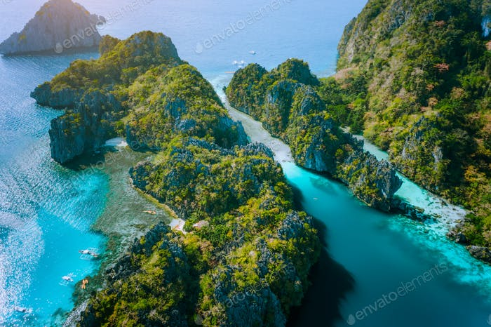 Aerial drone view of Big lagoon and majestic rocks. Discover explore El Nido, Palawan Philippines