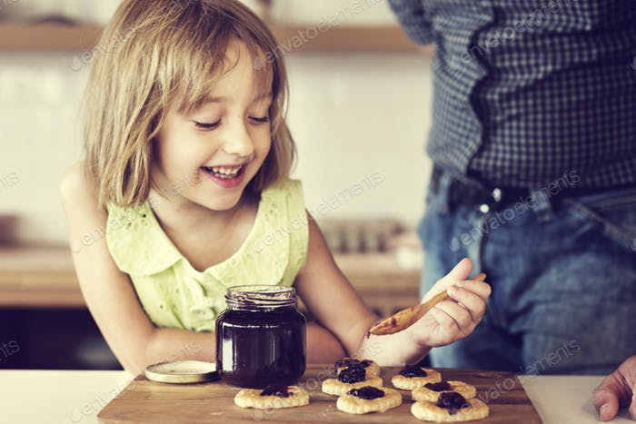 Little Girl Grandfather Bake Cookie Concept