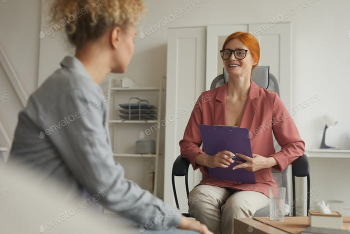 Woman talking to her client