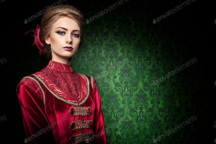 Gorgeous woman dressed vintage vogue clothes in retro interior
