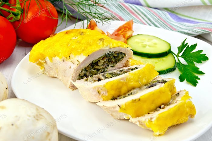 Roll chicken with mushrooms and cucumber on board