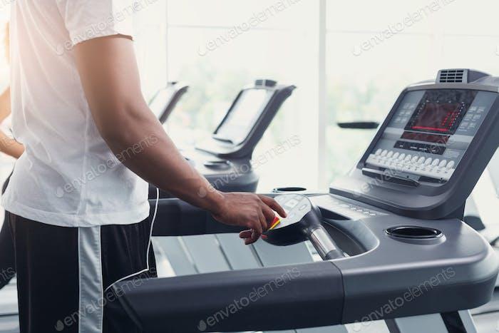 Closeup man's hands on treadmill