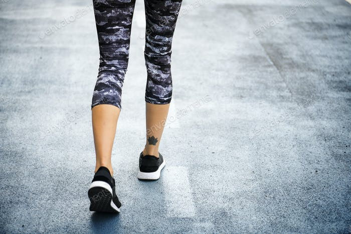 Woman jogging down the road