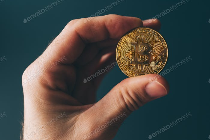 Bitcoin cryptocurrency in hand