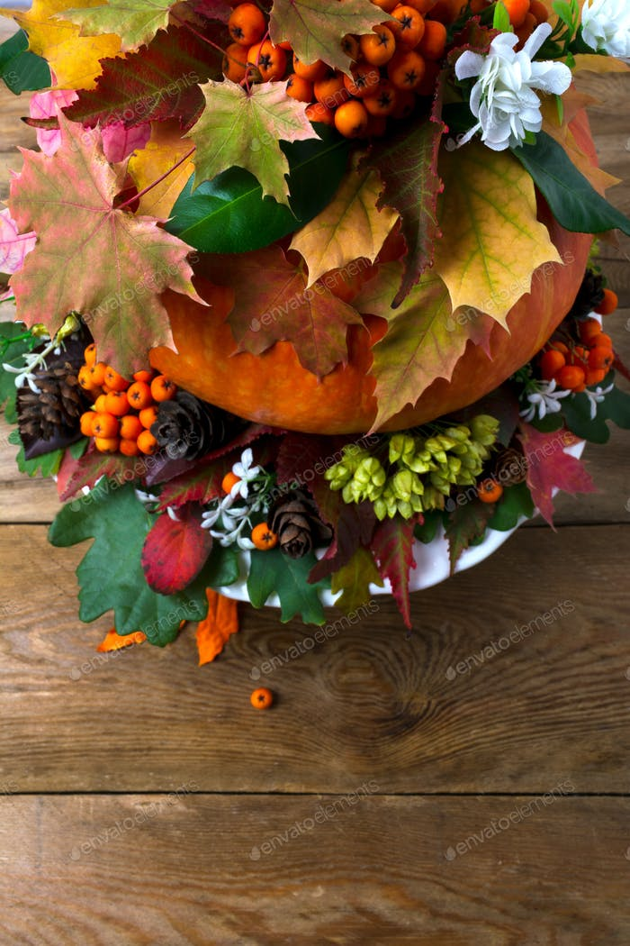 Thanksgiving table centerpiece with fall leaves and seeds, copy