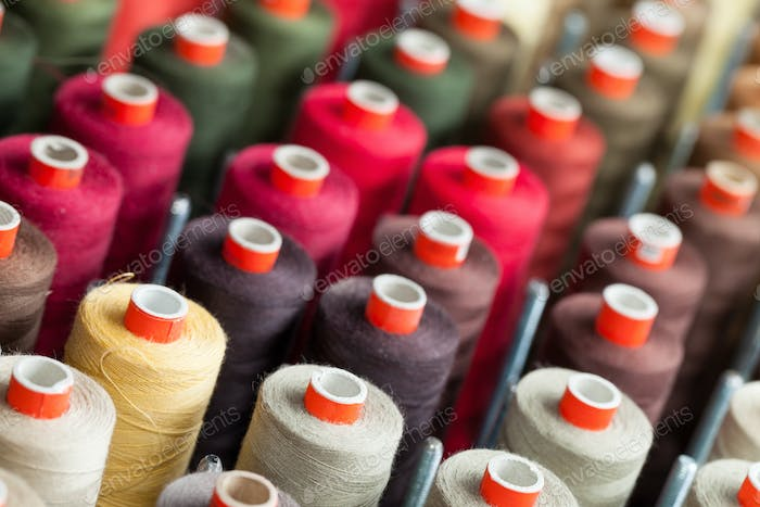 The reels with colorful threads