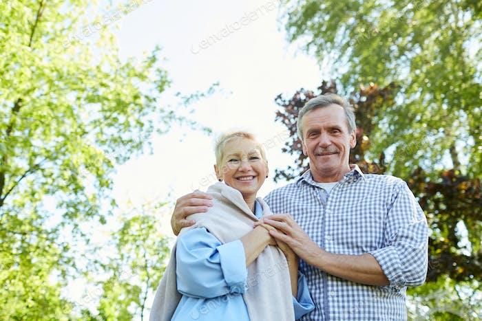 Smiling Senior Couple Walking in Park