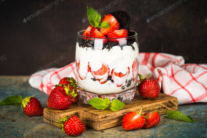 Strawberry dessert parfait with yogurt and chocolate cookies