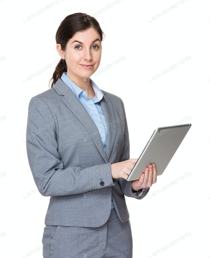 Caucasian businesswoman use of tablet pc