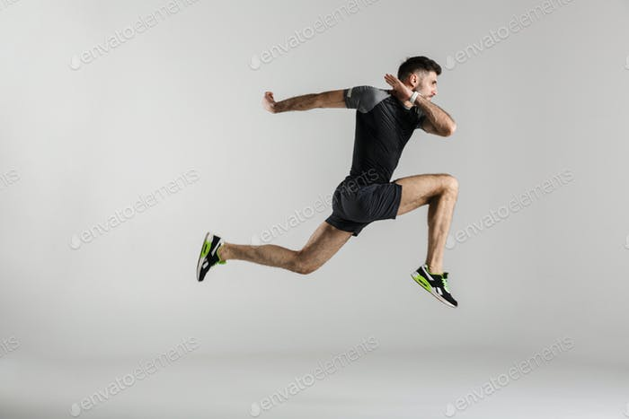 Image of caucasian athletic man jumping while working out