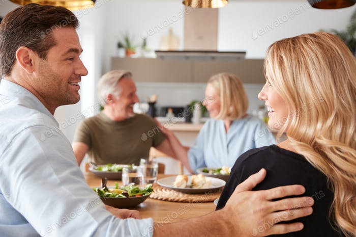 Introducing Boyfriend Or Girlfriend To Senior Parents At Meal Around Table At Home Together