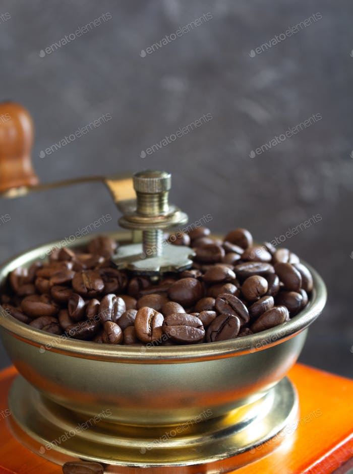 old vintage coffee grinder and beans