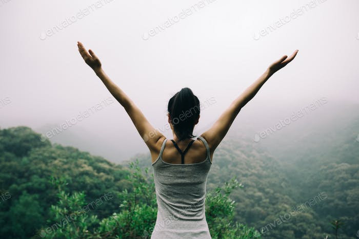Healthy lifestyle woman outstretched arms in spring forest