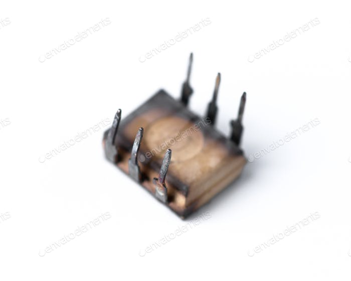 burnt microchip isolated on white background