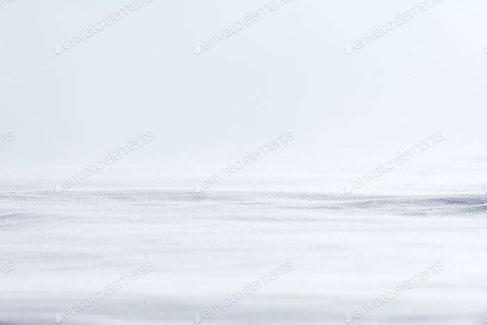 Beautiful winter background with snowy field. Natural winter texture.