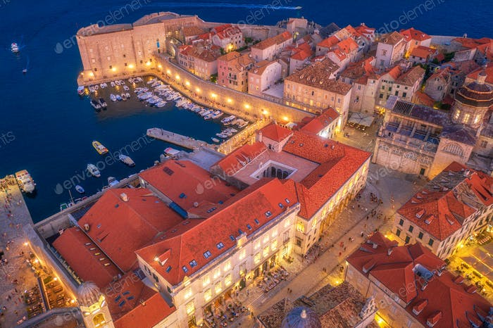 Aerial view of houses with red roofs at night in Dubrovnik