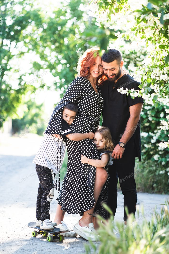 Mom, Dad, little son and daughter have fun