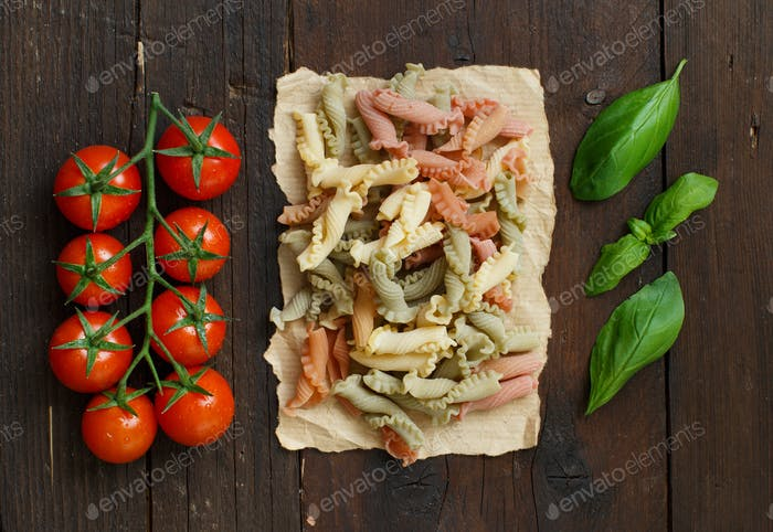 Tricolor pasta, tomatoes and basil