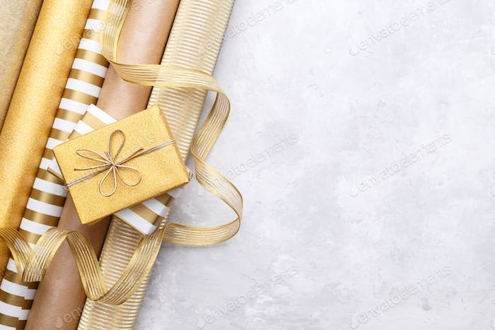 Gold wrapping paper and gift boxes