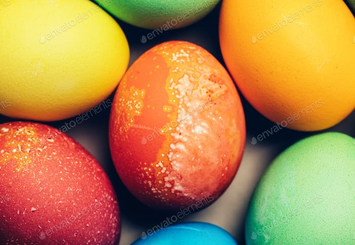 Colorful textured eggs in a close-up shot.
