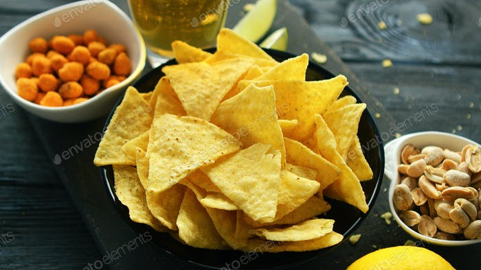 Plate of corn chips with nuts
