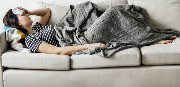 Woamn sick at home on the couch