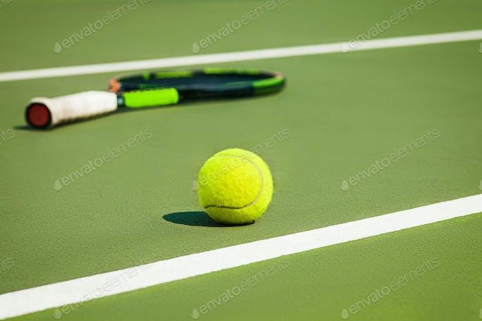 The tennis ball on a tennis court