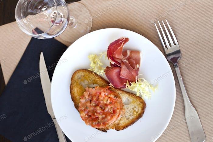 Salmon tartare and ham on a toast