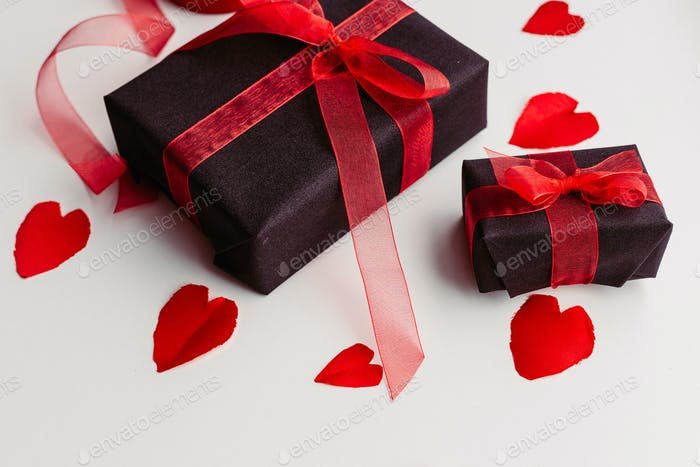 Gift with red ribbon and hearts