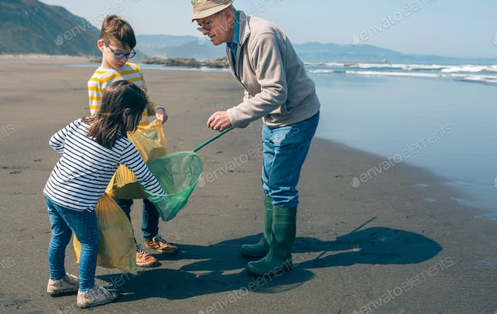 Volunteers taking garbage out of the sea