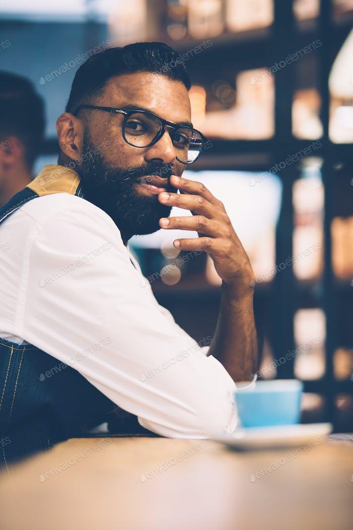 African man sitting in coffee shop
