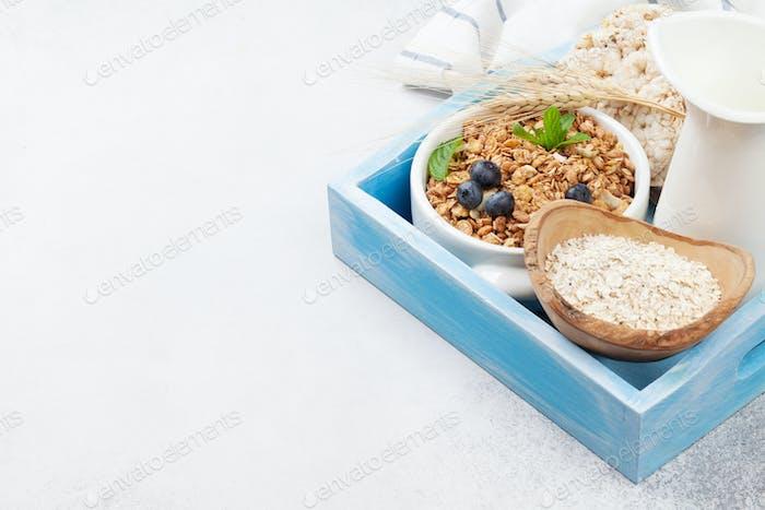 Healthy breakfast with muesli, berries and milk