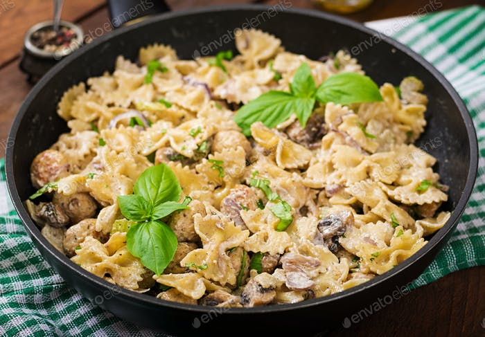 Pasta with meatballs and mushrooms in creamy sauce