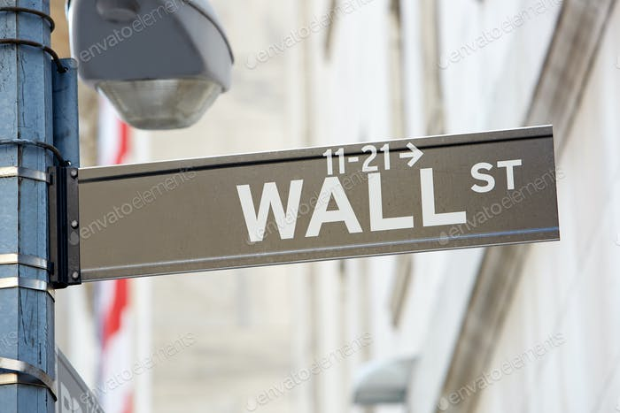 Wall Street sign with street lamp near Stock Exchange in New York