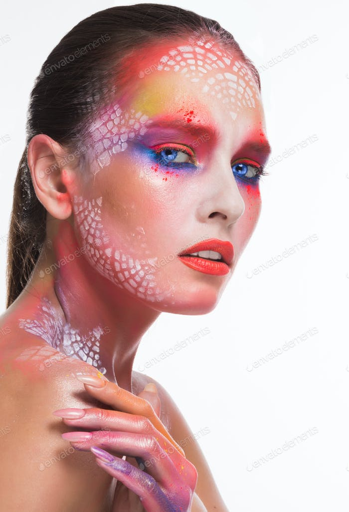 Pensive beautiful girl with bright artistic make-up