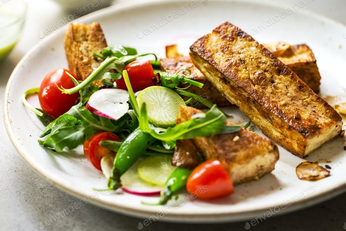 Tofu steak with Snow Peas and Rocket Salad