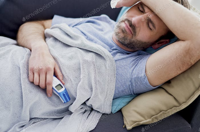 Man with high temperature staying at home