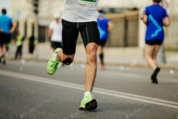 legs male runner running street city