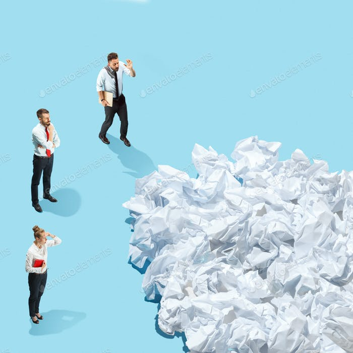 Creative work background with crumpled up paper, office objects and room for text