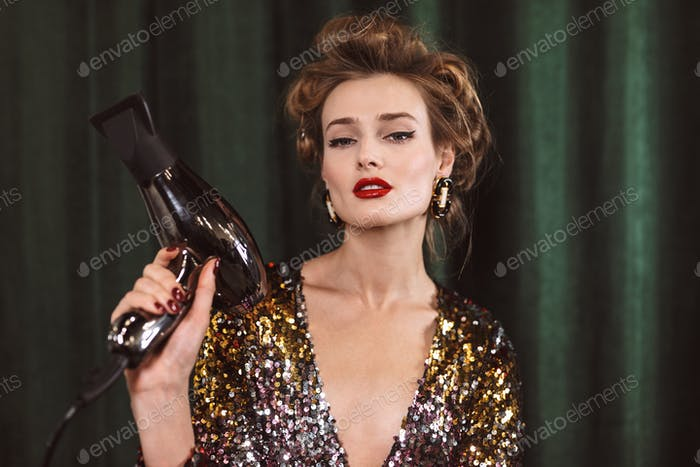 Young gorgeous lady with wavy hairstyle and red lips in bright c