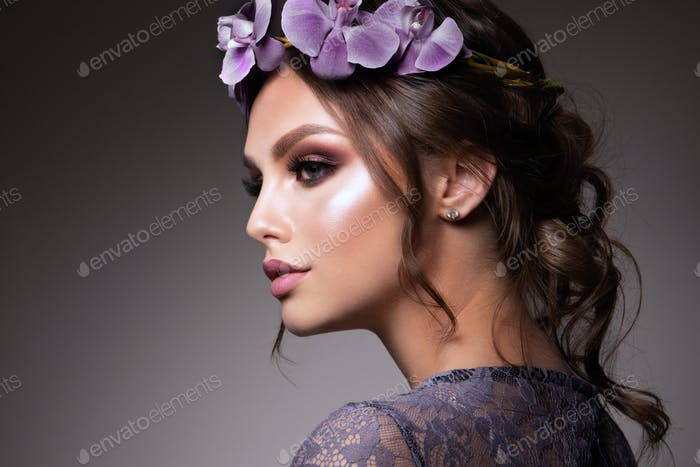 Beautiful Girl with Flowers. Pastel Colors. Perfect Face Skin
