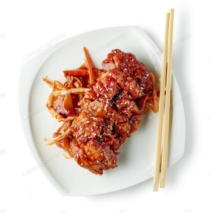 plate of fried meat in teriyaki sauce