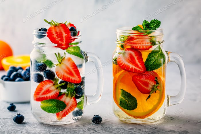 Infused detox water with blueberry, strawberry, orange and mint.